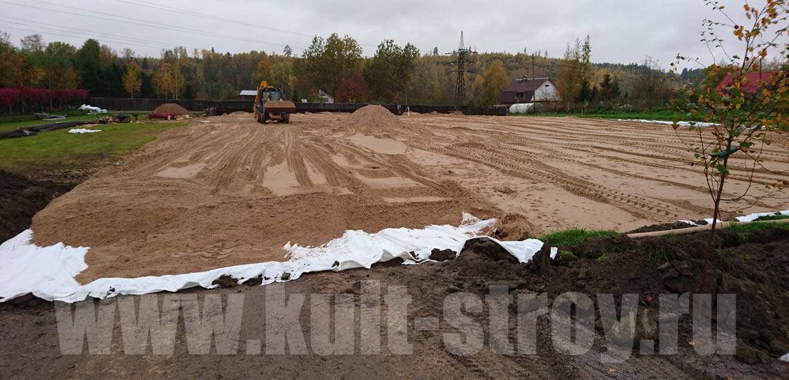 засыпка песком основания под фундамент